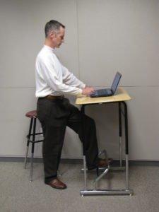 Mark Benden at a desk he designed
